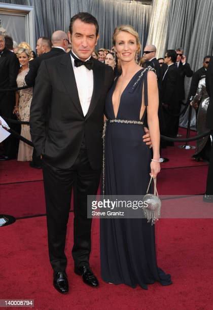 Actor Jean Dujardin and Alexandra Lamy arrive at the 84th Annual Academy Awards held at the Hollywood Highland Center on February 26 2012 in...