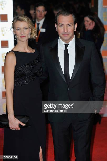 Actor Jean Dujardin and Alexandra Lamy attend the Orange British Academy Film Awards 2012 at the Royal Opera House on February 12 2012 in London...