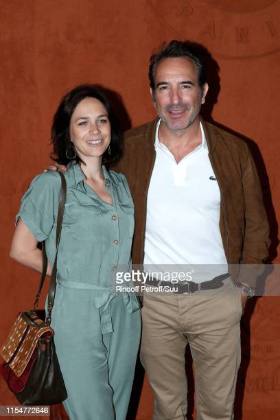 Actor Jean Dujardin and his wife Ice skater Nathalie Pechalat attend the 2019 French Tennis Open Day Fifteen at Roland Garros on June 09 2019 in...