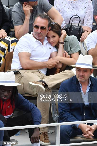 Actor Jean Dujardin and his wife Ice skater Nathalie Pechalat attend the 2019 French Tennis Open Day Fifteenth at Roland Garros on June 09 2019 in...
