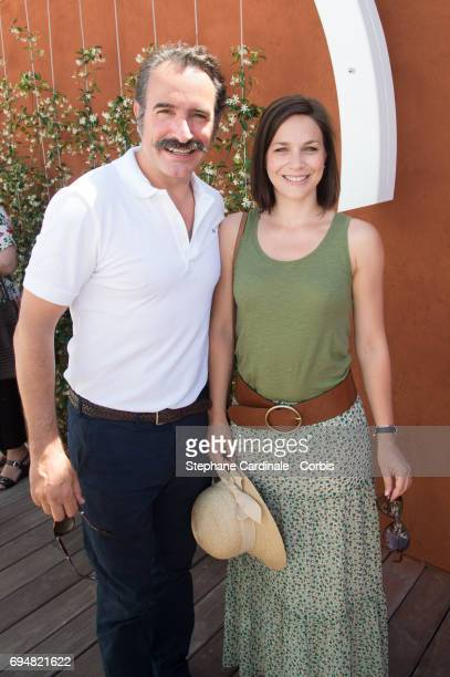 Actor Jean Dujardin and Nathalie Pechalat attend the French Tennis Open 2017 Day Fifthteen at Roland Garros on June 11 2017 in Paris France