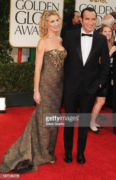 Actor Jean Dujardin and wife Alexandra Lamy arrive at the 69th Annual Golden Globe Awards held at the Beverly Hilton Hotel on January 15 2012 in...