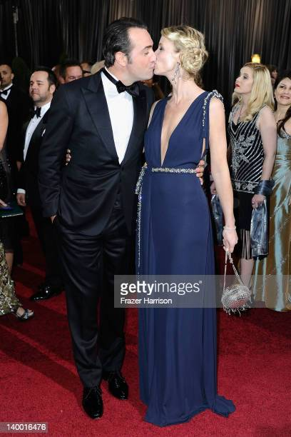 Actor Jean Dujardin and wife Alexandra Lamy arrive at the 84th Annual Academy Awards held at the Hollywood Highland Center on February 26 2012 in...