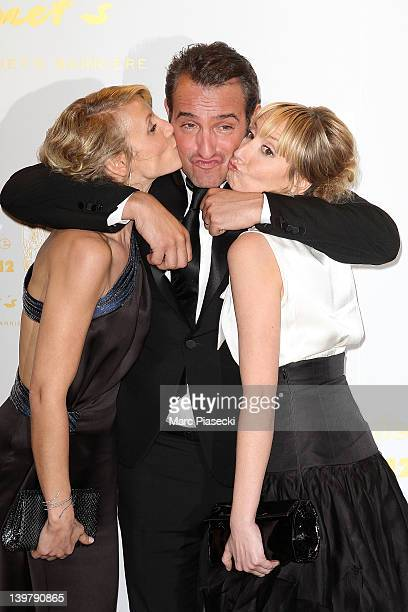Actor Jean Dujardin his wife Alexandra Lamy and her sister Audrey Lamy attend the 37th Cesar Film Awards at Theatre du Chatelet on February 24 2012...