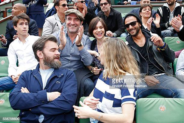 Actor Jean Dujardin Nathalie Pechalat singer Maxime Nucci actors Clovis Cornillac and his wife Lilou Fogli attend Day Fifteen Men single's Final of...