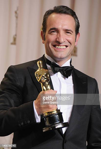 Actor Jean Dujardin poses in the press room at the 84th Annual Academy Awards held at the Hollywood Highland Center on February 26 2012 in Hollywood...