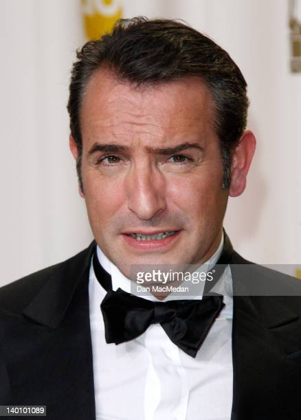 Actor Jean Dujardin poses in the press room at the 84th Annual Academy Awards held at Hollywood Highland Center on February 26 2012 in Hollywood...
