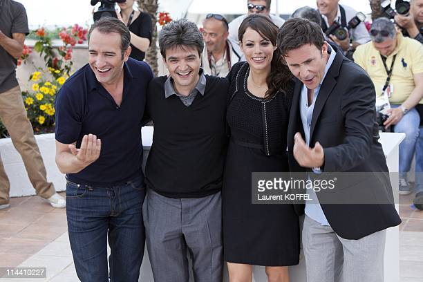 Actor Jean Dujardin producer Thomas Langmann actress Berenice Bejo and director Michel Hazanavicius attend 'The Artist' Photocall at the Palais des...