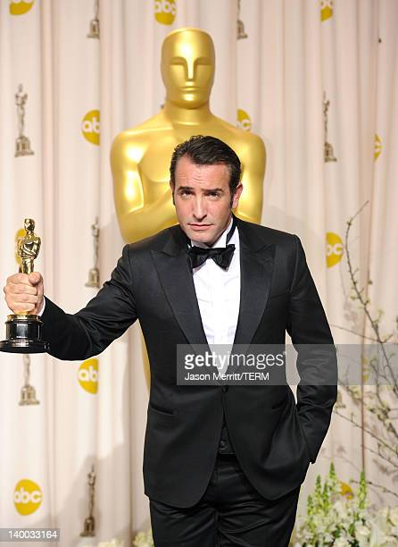 Actor Jean Dujardin winner of the Best Actor Award for 'The Artist' poses in the press room at the 84th Annual Academy Awards held at the Hollywood...