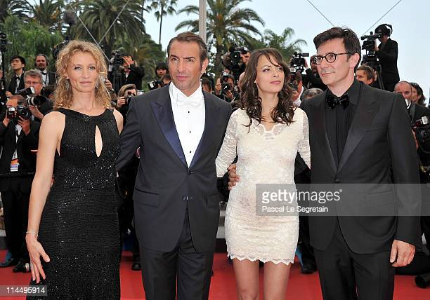 Actor Jean Dujardin with Alexandra Lamy actress Berenice Bejodirector Michel Hazanavicius attend the Les BienAimes premiere at the Palais des...