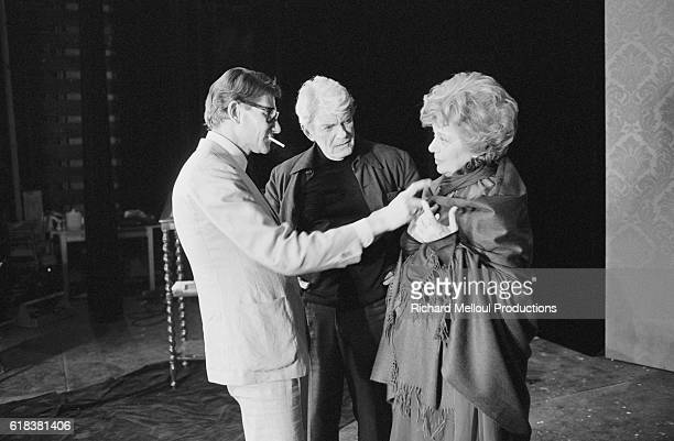 Actor Jean Marais watches as fashion designer Yves Saint Laurent fits a costume to Edwige Feuillere for an upcoming production of Dear Liar The play...