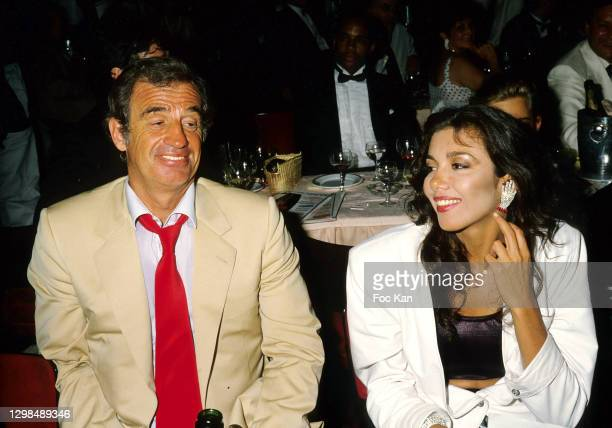 Actor Jean Paul Belmondo and Carlos Sotto Mayor attend a Cocktail Party at the Lido on 1986, in Paris, France.