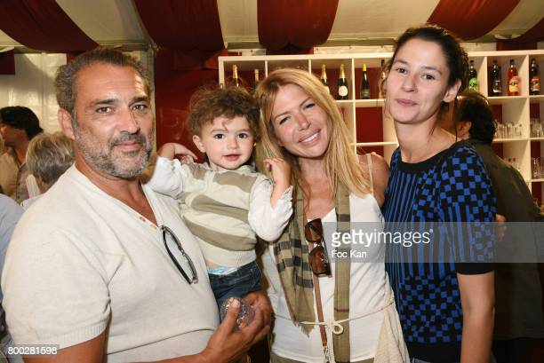 Actor Jean Pierre Martins his baby Alexandra Genoves and Pandora Demules attend La Fete des Tuileries on June 23 2017 in Paris France