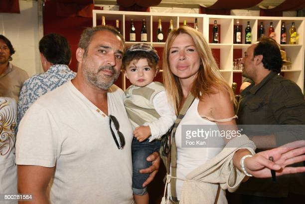 Actor Jean Pierre Martins his baby and Alexandra Genoves attend La Fete des Tuileries on June 23 2017 in Paris France