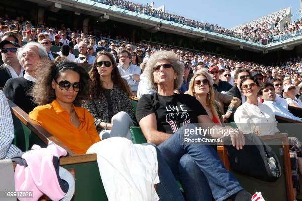 Actor Jean Rochefort and his daughter Clemence Director Elie Chouraqui and his wife Isabel Singer Lio and her daughter Nubia attend Roland Garros...