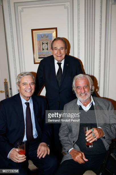 Actor Jean Sorel director Robert Hossein and actor JeanPaul Belmondo attend Robert Hossein celebrates his 90th Anniversary at 'Laurent Restaurant' on...