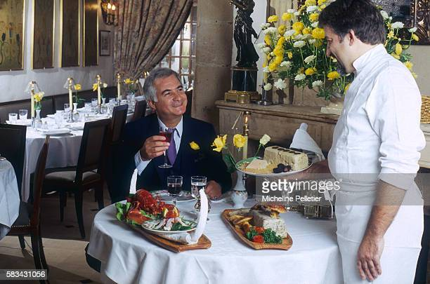 Actor JeanClaude Brialy enjoys a meal in his Paris restaurant L'Orangerie An accomplished actor Brialy opened the upscale restaurant in 1966