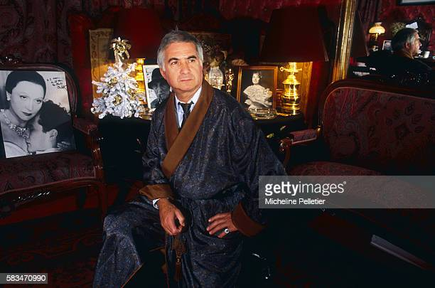 Actor JeanClaude Brialy relaxes in his dressing room at the Bouffes Parisiens theater in Paris