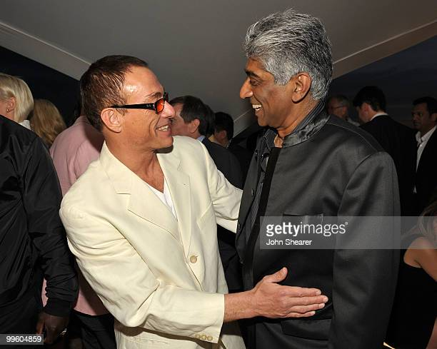 Actor JeanClaude Van Damme and producer Ashok Amritraj attend the Variety Celebrates Ashok Amritraj event held at the Martini Terraza during the 63rd...