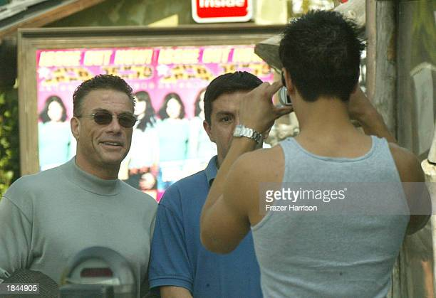 Actor JeanClaude Van Damme talks to friends on Sunset Boulevard on March 12 Hollywood California