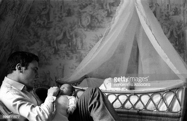 Actor JeanLouis Trintignant with his Daughter Marie Trintignant at Home in Paris France in 1962