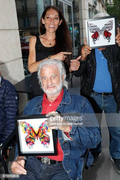 Actor JeanPaul Belmondo his daughter Charlotte Joly and his brother Alain Belmondo attend the Street Art butterflies by Charlotte Joly Exhibition...