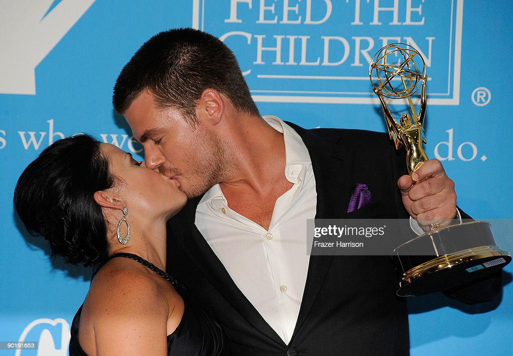 Actor Jeff Branson (R) and guest pose in the press room at the 36th Annual Daytime Emmy Awards at The Orpheum Theatre on August 30, 2009 in Los Angeles, California.