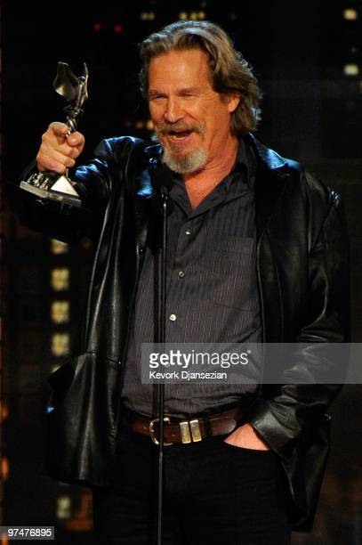 Actor Jeff Bridges accepts Best Male Lead award for Crazy Heart onstage during the 25th Film Independent's Spirit Awards held at Nokia Event Deck at...