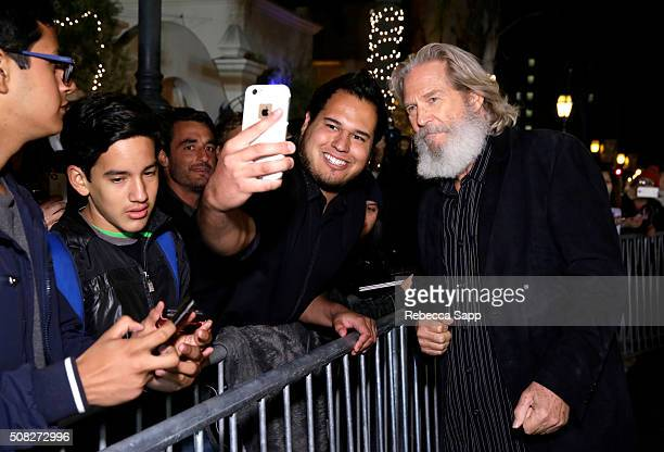 Actor Jeff Bridges and a fan take selfies at the opening night presentation of 'The Little Prince' at the Arlington Theater during the 31st Santa...