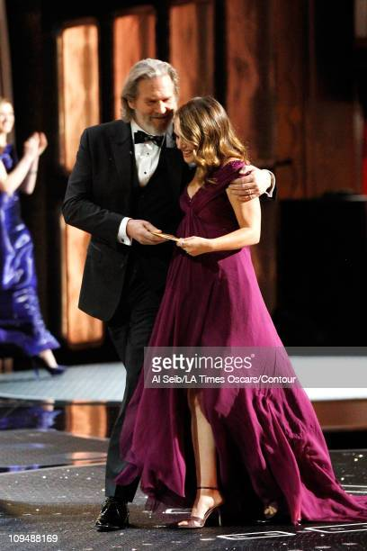 Actor Jeff Bridges and actress Natalie Portman winner of Best Actress in a Leading Role walk offstage at the 83rd Annual Academy Awards held at the...