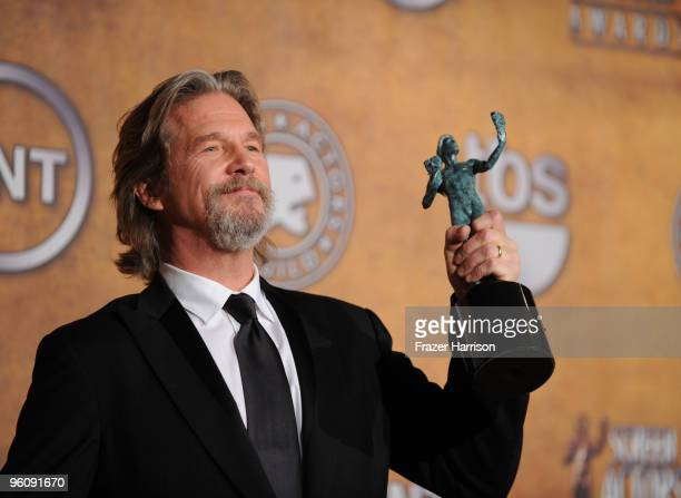 Actor Jeff Bridges poses with the Male Actor In A Leading Role award for 'Crazy Heart' in the press room at the 16th Annual Screen Actors Guild...