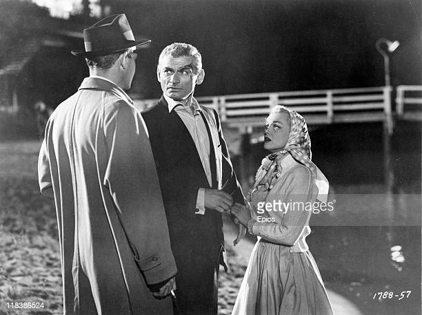 Actor Jeff Chandler and actress Jan Sterling in a scene from the crime drama movie 'Female On The Beach', directed by Joseph Pevney, 1955.
