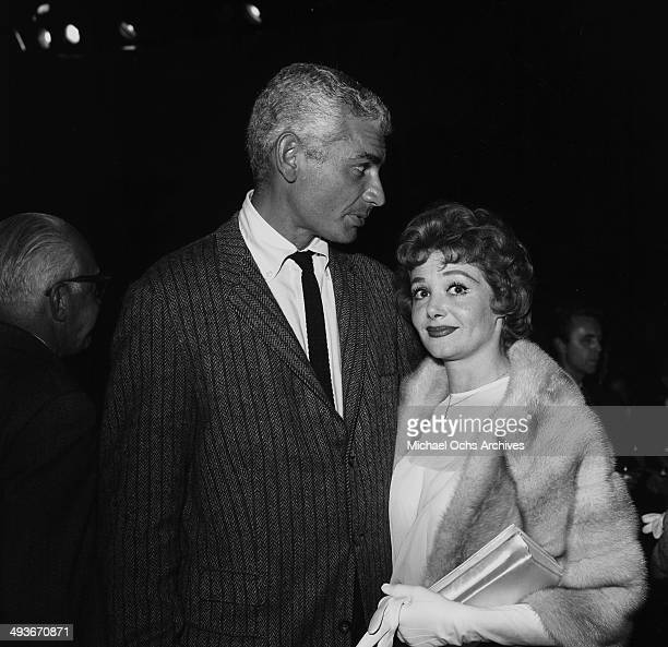 Actor Jeff Chandler attends a party with guest in Los Angeles California