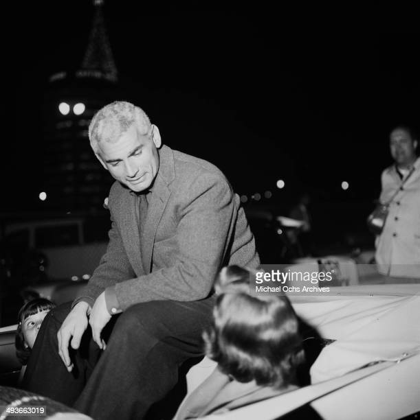 LOS ANGELES CALFORNIA NOVEMBER 28 1957 Actor Jeff Chandler rides in the car during the Hollywood Christmas Parade in Los Angeles California