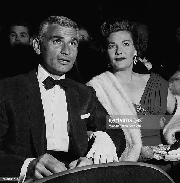 LOS ANGELES CALFORNIA FEBRUARY 16 1956 Actor Jeff Chandler with his wife Marjorie attend a premiere of Carousel in Los Angeles California