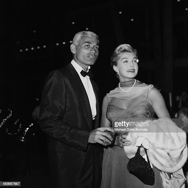 Actor Jeff Chandler with wife attend a party in Los Angeles California