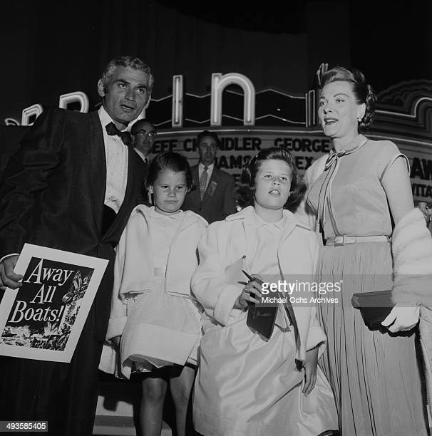 Actor Jeff Chandler with wife Marjorie and daughters Dana and Jamie attends the movie premiere of Away All Boats in Los Angeles California