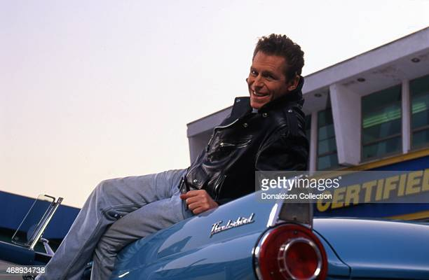 Actor Jeff Conaway poses for a portrait on his Ford Thunderbird in circa 1991 in Los Angeles California