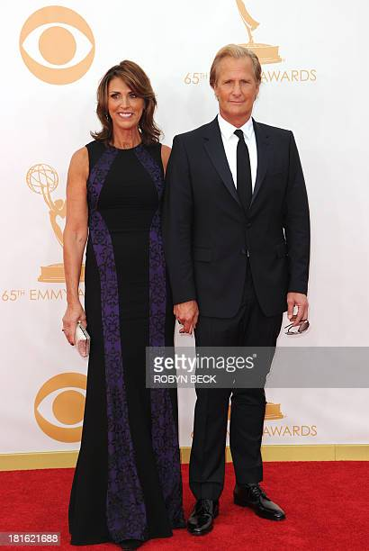 Actor Jeff Daniels and his wife Kathleen Treado arrive on the red carpet for the 65th Emmy Awards in Los Angeles California on September 22 2013 AFP...