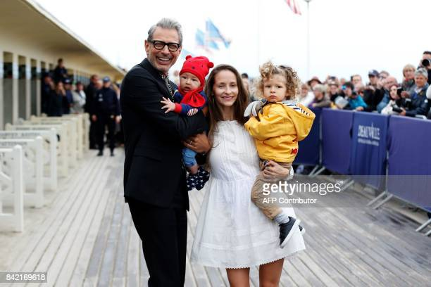 US actor Jeff Goldblum his son River his wife Canadian dancer Emilie Livingston and her daughter Charlie pose in front of Goldblum's dedicated beach...