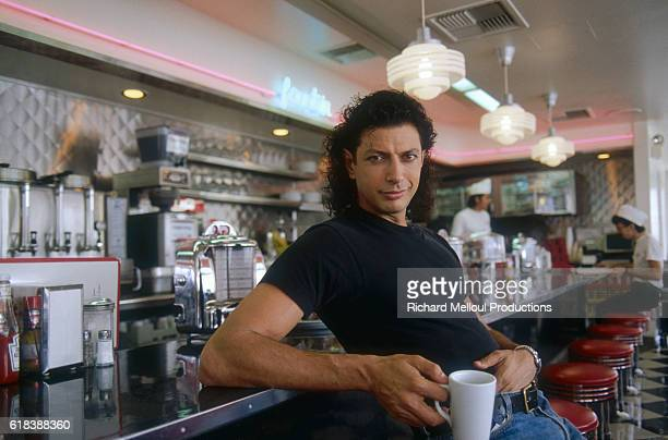 Actor Jeff Goldblum holds a cup of coffee in a 1950sstyle diner in Los Angeles