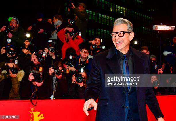 US actor Jeff Goldblum jokes on the red carpet for the opening ceremony of the 68th Berlinale film festival with the premiere of Isle of Dogs on...