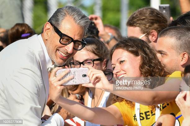 Actor Jeff Goldblum poses for a selfie photo with a fan as he arrives for the premiere of the film The Mountain presented in competition on August 30...