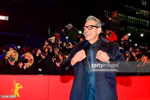 US actor Jeff Goldblum poses on the red carpet for the opening ceremony of the 68th Berlinale film festival with the premiere of their film on...