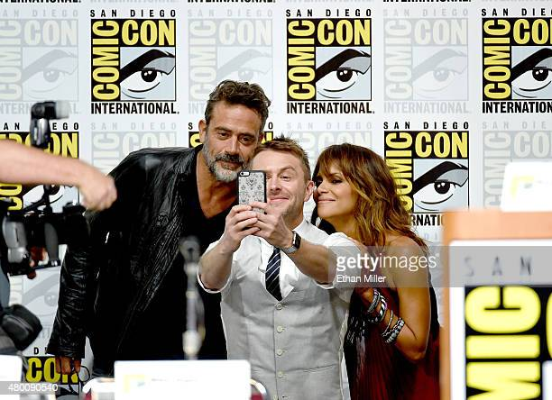 Actor Jeffrey Dean Morgan TV host Chris Hardwick and actress Halle Berry pose fo a selfie onstage during the CBS TV Studios' panel for Extant during...