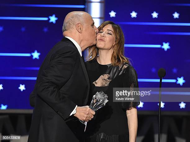 Actor Jeffrey Tambor accepts Best Actor in a Comedy Series award for 'Transparent' from actress Carrie Brownstein onstage during the 21st Annual...