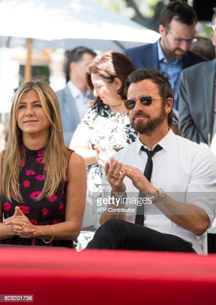 Actor Jennifer Aniston and Justin Theroux attend Jason Bateman's star unveiling ceremony on the Hollywood Walk of Fame on July 26 in Hollywood...