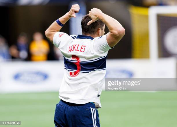Actor Jensen Ackles points to the back of his jersey during the Vancouver Whitecaps FC Legends And Stars Charity Soccer Match at BC Place on...
