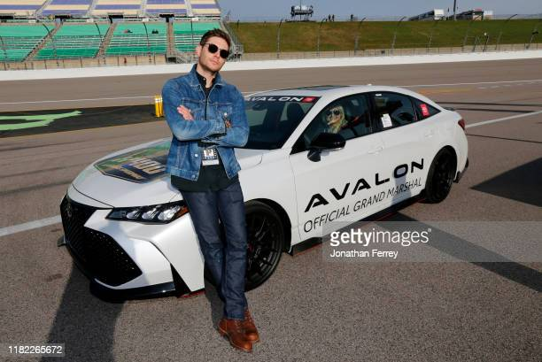 Actor Jensen Ackles poses by the Grand Marshall pace car before the Monster Energy NASCAR Cup Series Hollywood Casino 400 at Kansas Speedway on...