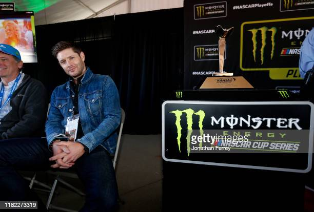 Actor Jensen Ackles poses by the trophy during the driver's meeting before the Monster Energy NASCAR Cup Series Hollywood Casino 400 at Kansas...